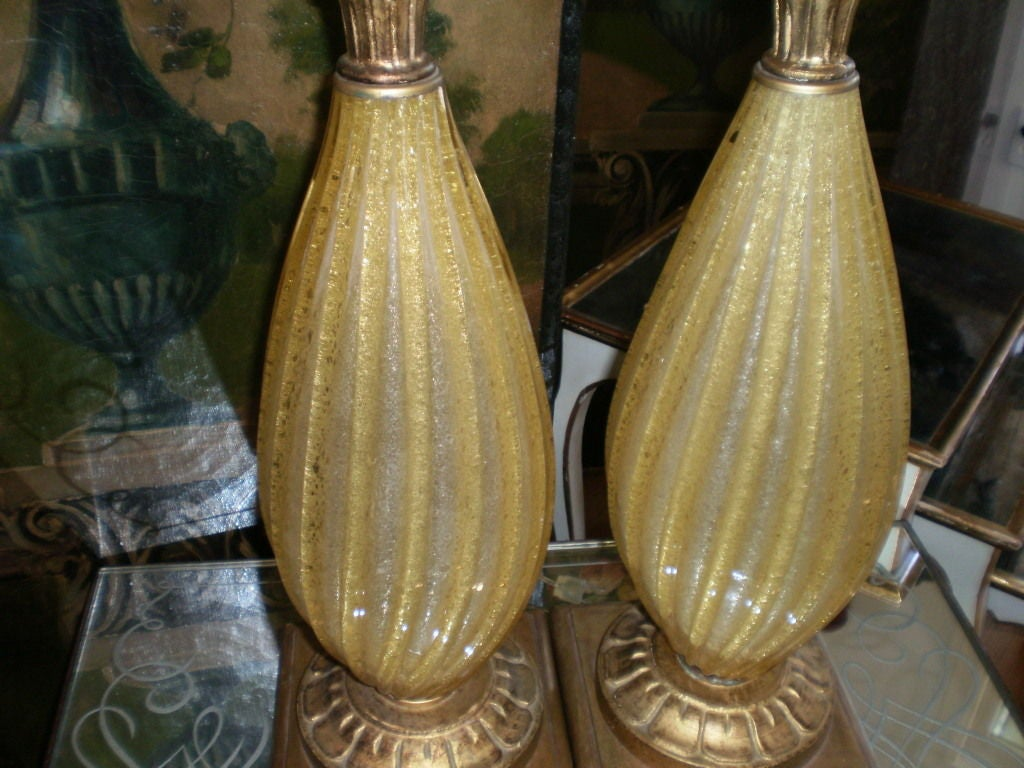 Gorgeous pair of Murano glass lamps, yellow with gold flecks on giltwood bases, newly wired.