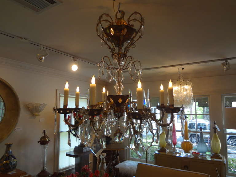 Chic French 1940s Maison Baguès style bronze or brass and crystal eight-light chandelier. This stunning French crystal chandelier has been newly wired for U.S. market and would look great over a dining table or in an entrance hall. Can be suspended