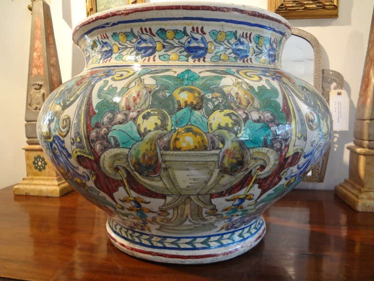 Grand Italian hand-painted Majolica, faience or glazed earthenware jardiniere or planter from the late 19th century. This fabulous exceptionally large 19th century Italian urn is a versatile piece that could be used in a variety of locations and