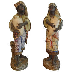 Pair of Antique Polychrome Plaster Blackamoor Figures