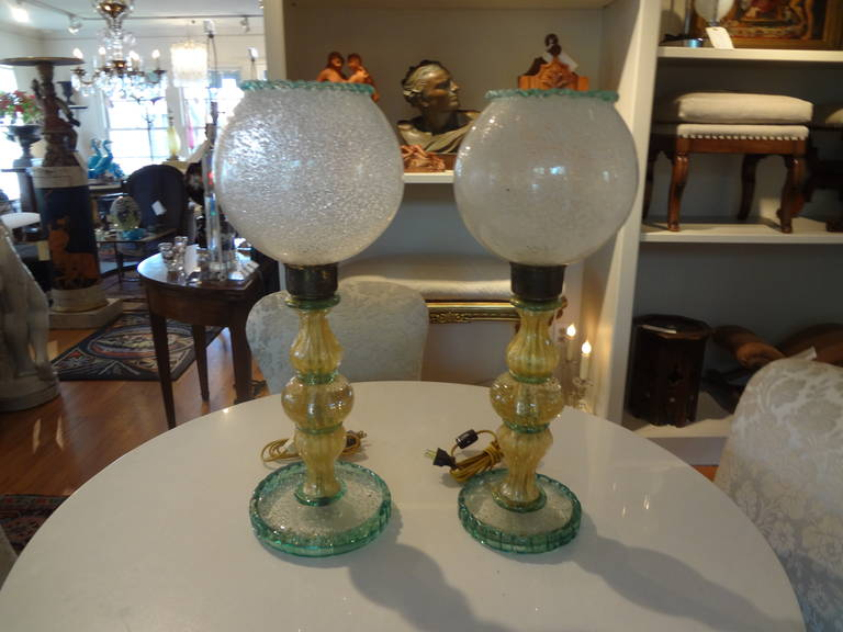 Unusual pair of Murano glass lamps from the 1940s (one slightly taller with slightly larger base, they are individually handblown.)