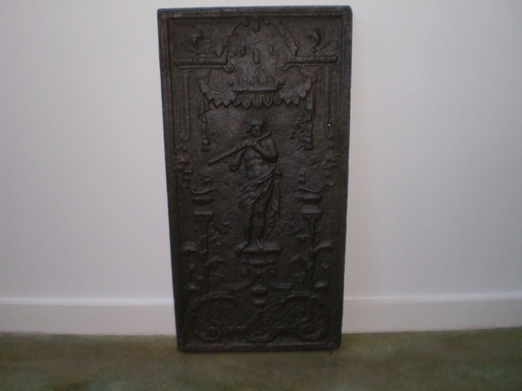 Handsome French cast iron fire back/fireplace back from Normandy. Great item to use behind a kitchen stove or in a summer kitchen.