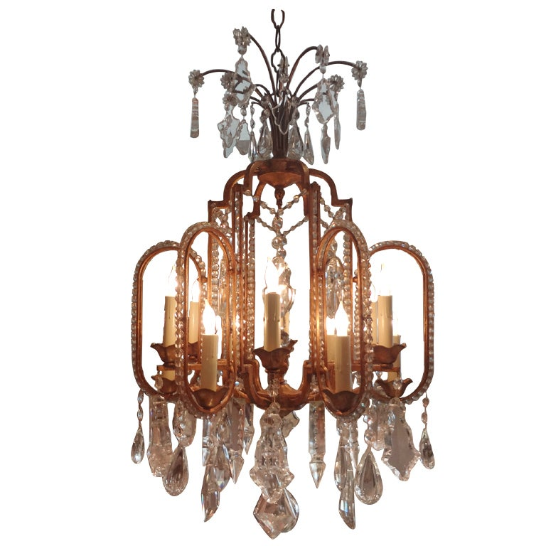 French Gilt Iron Beaded And Crystal 12 Light Chandelier At