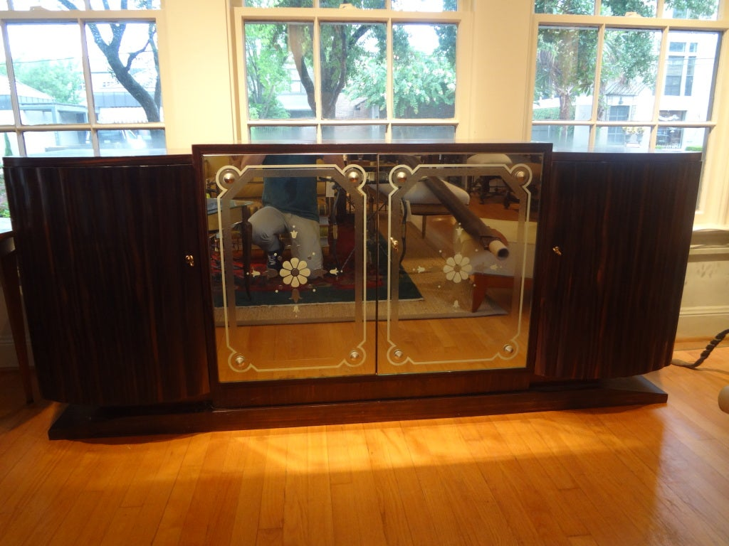 Glamorous French Art Deco four-door buffet/ credenza/chest with mirrored center doors.