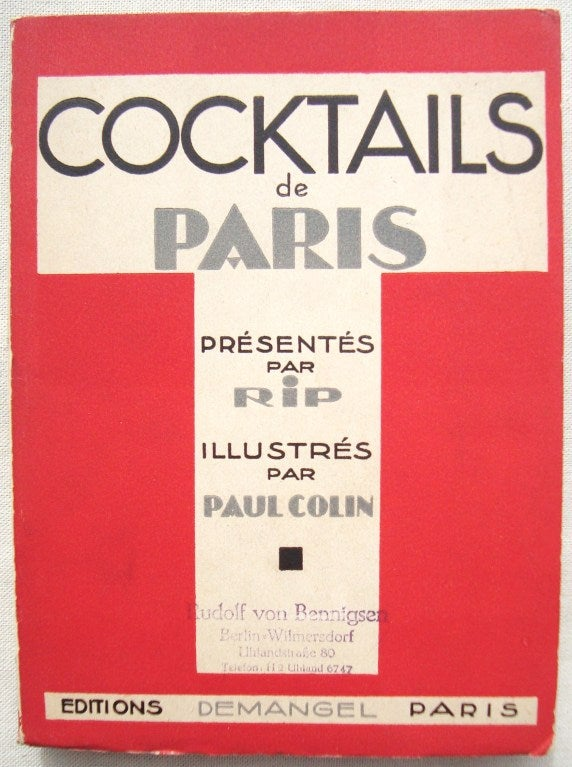 Very scarce Cocktails de Paris book, 1929 by Paul Colin.  These were printed in a very limited edition of only 100 copies worldwide. Volume is interspersed with art deco period advertisements.