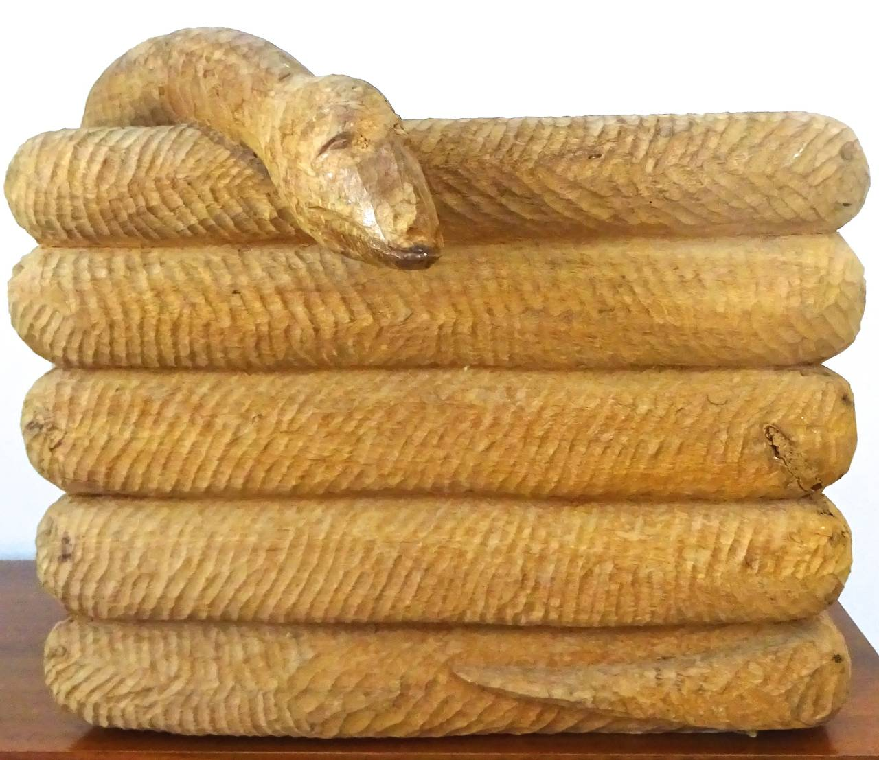 S carved wood coiled snake trough with zinc liner at