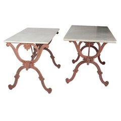 A Pair of Tables with Bull Heads Decoration with a White Marble Top