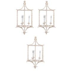 A Set of Three Cream Painted Faux Bamboo Tole Chinoiserie Lanterns