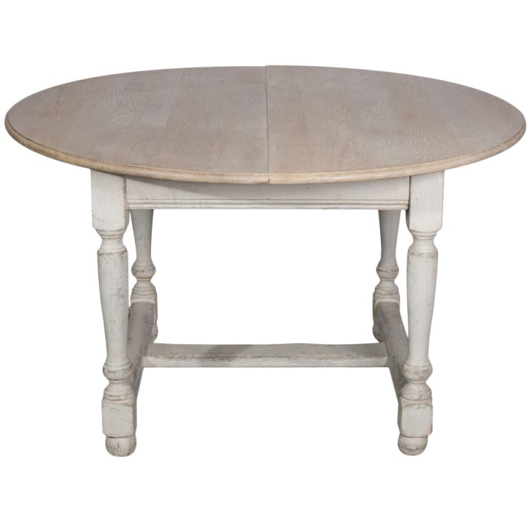 A Painted Dining Table With Two Leaves