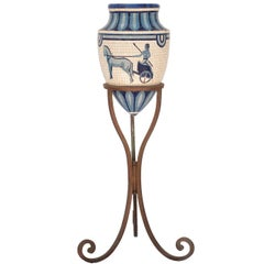 Blue and White Mosaic Urn on a Wrought Iron Stand