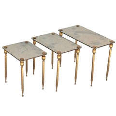 A Set of Three Brass Side Tables with Mirror Tops