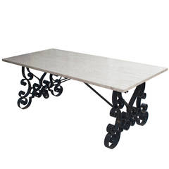 Cast Iron Table with a Travertine Top with Two Wooden Extension Leaves