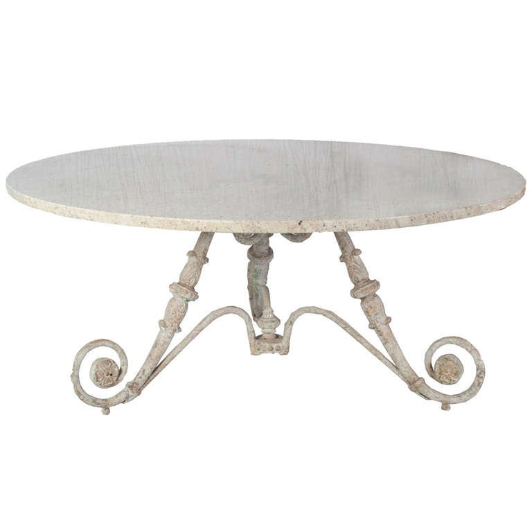 Large Round Table With A Cast Iron Base