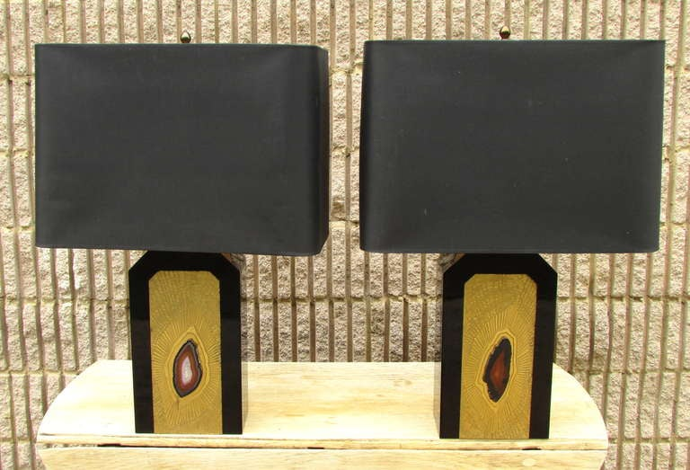 Pair of acid etched bronze with agate lamps by George Mathias each is signed includes original shades.
