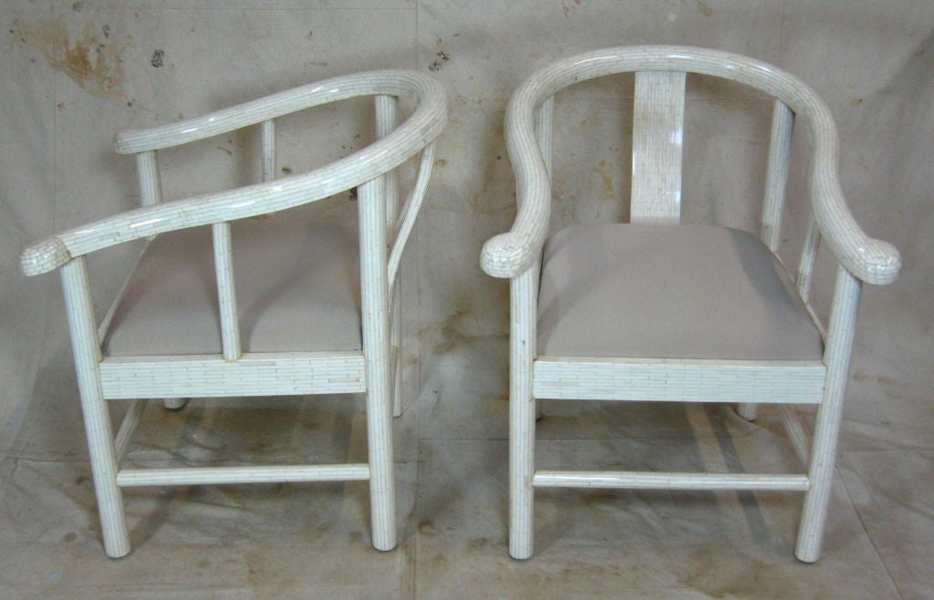 Pair of tessellated bone horseshoe shaped armchairs with upholstered seats.