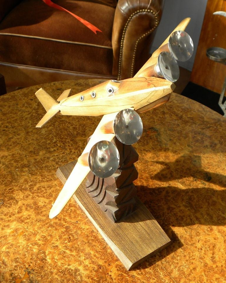Very original wooden and chrome model of a four engined plane, it's a good looking piece with lots of nice details. Fuselage and engines are carved from solid Walnut with chrome propellers, it's in very good condition, stands on a metal chrome