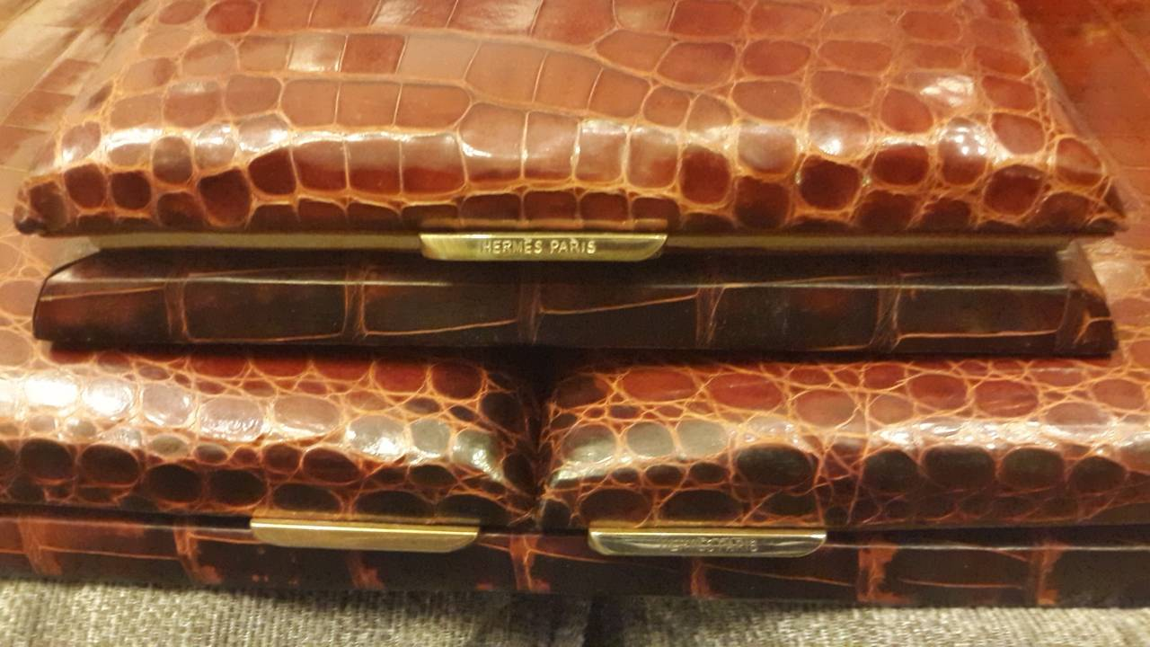 French Art Deco by Hermès, very fine four-piece desk set in rich deep brown crocodile skin. May have been designed by Paul Dupré-Lafon for Hermès best known for these highly stylized fancy desk suits.