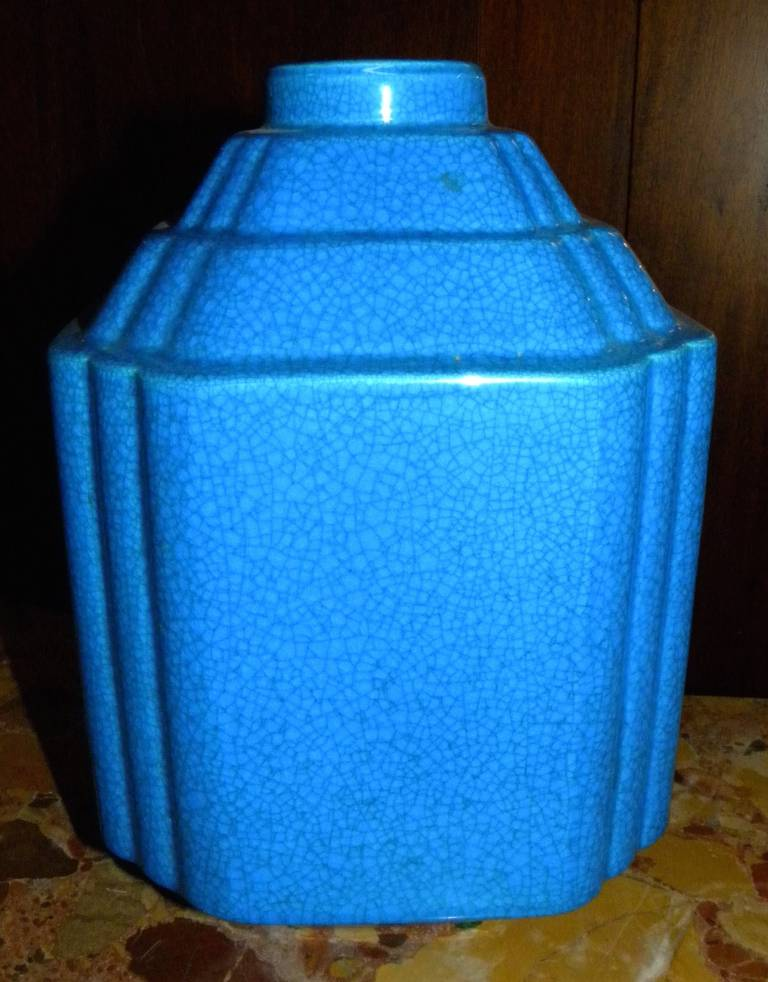 Boch Freres ceramics made during the Charles Catteau period are very desirable. This modernist shape is simple, completed in solid blue-turquoise color outlining a very desirable shape. The shape was utilized a lot as one of the great decorative