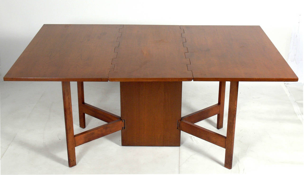 Dining table and six chairs designed by george nelson for