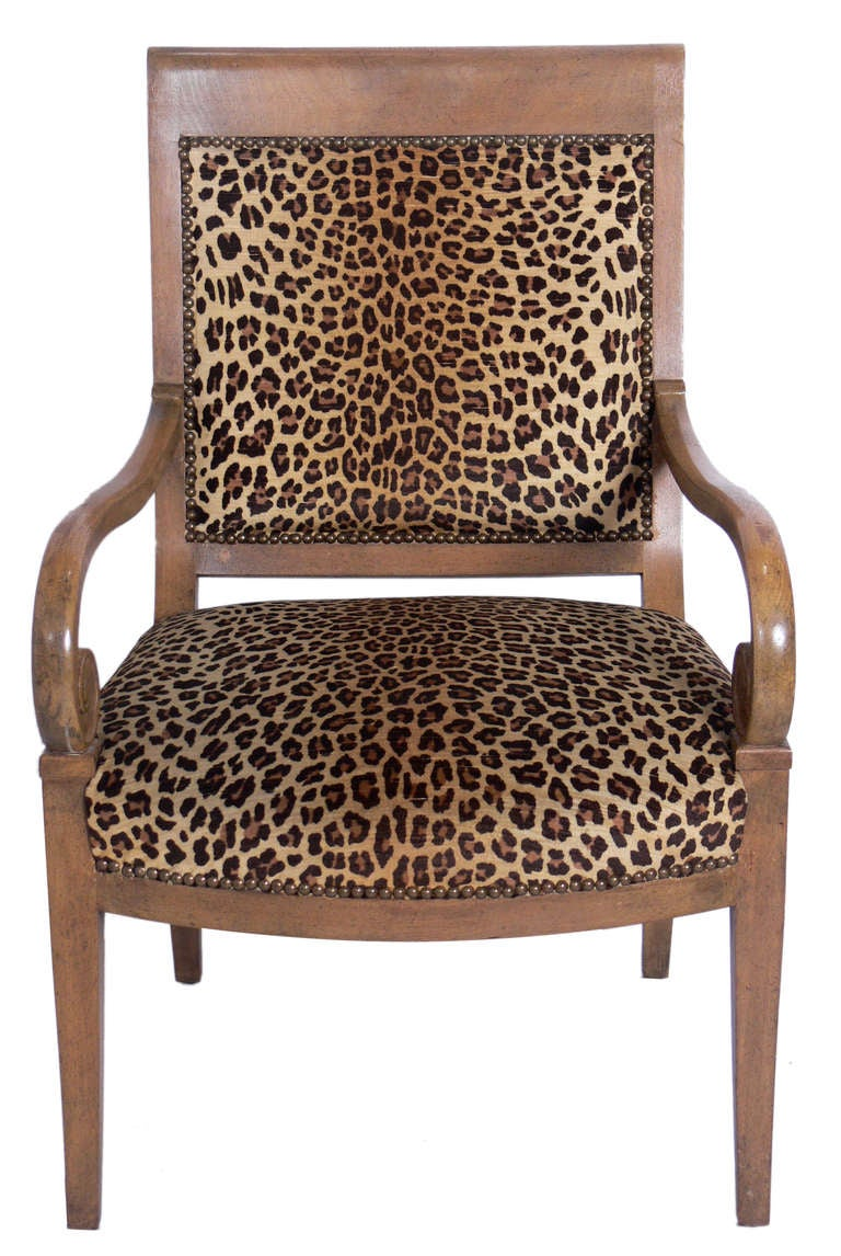 Curvaceous Armchair in Original Faux Leopard Upholstery, American, circa 1950's. This chair looks great from any angle and is quite comfortable.