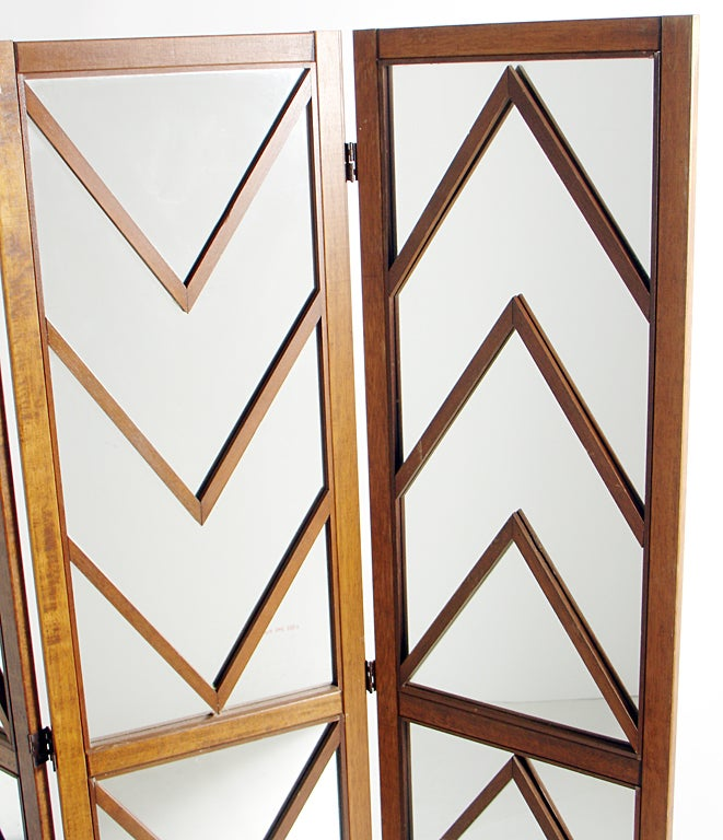 Glamorous Mirrored Chevron Folding Screen, circa 1960's. This piece is finished on the back in nicely grained walnut, so it looks great from either side. Nice attention to detail. Three hinged panels open to various angles to suit your needs. This