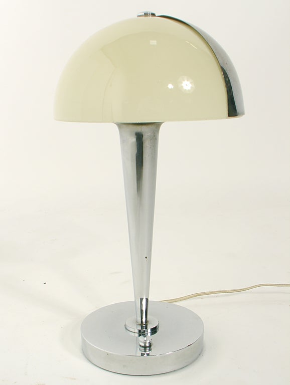 Art Deco Lamp by Jean Perzel, French, circa 1930's. The shade has an ingenious rotating metal diffuser, which allows you to focus the light where you want it. Signed on the base with impressed signature.