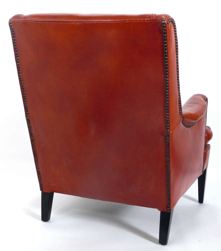 American Curvaceous 1940's Lounge Chair in Original Burnt Orange Leather For Sale
