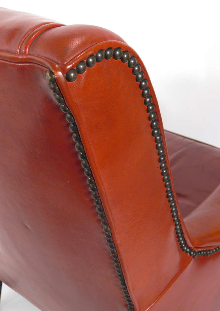 Mid-20th Century Curvaceous 1940's Lounge Chair in Original Burnt Orange Leather For Sale