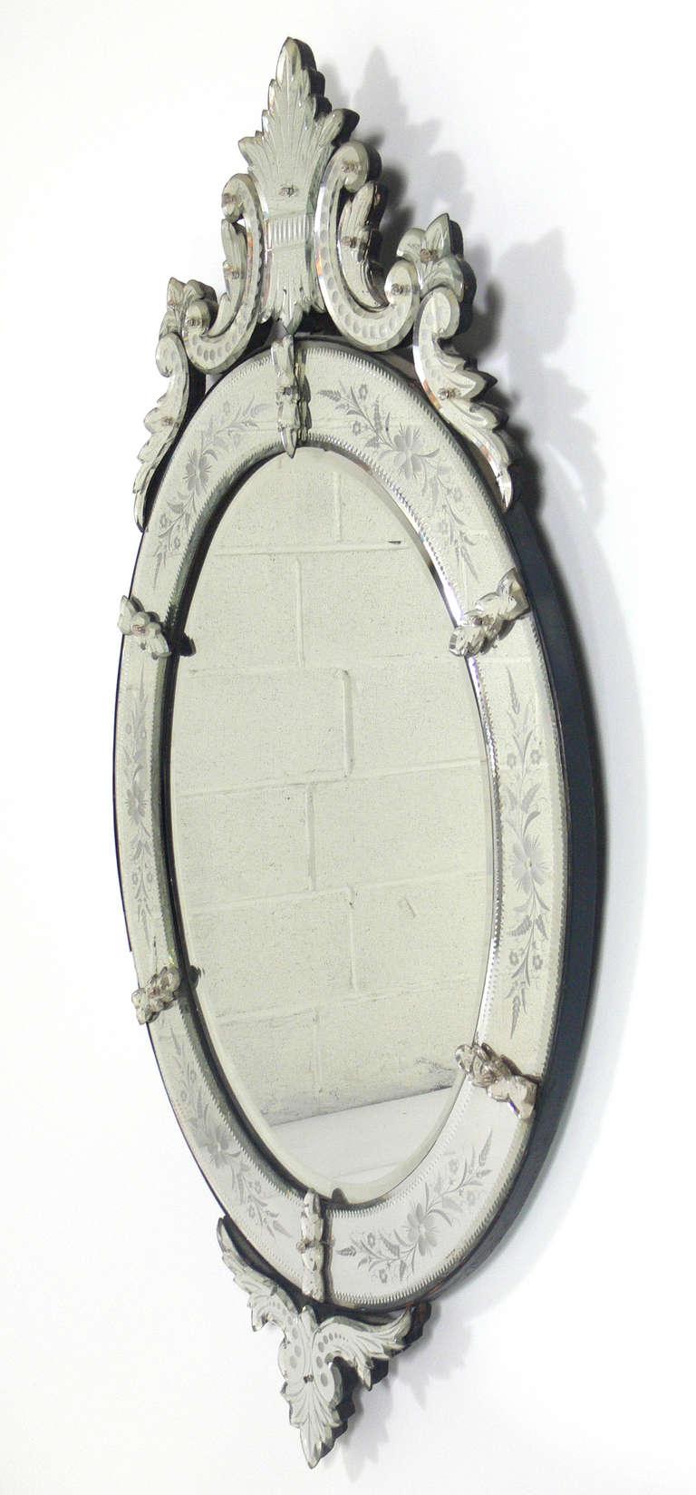 Elegant 19th Century Oval Venetian Mirror, Italy, circa 1890's. Retains wonderful original patina to the mirrored glass.