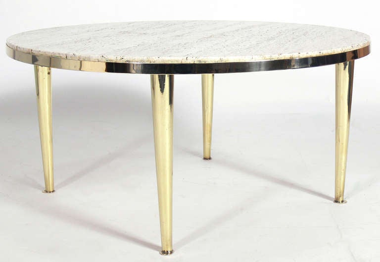 Modernist Brass and Travertine Coffee Table, Italy, circa 1950's. The brass feet are stamped Italy. The brass base has been hand polished and lacquered.