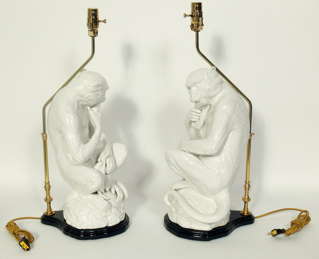 Pair of Italian White Ceramic Monkey Lamps, Italy, circa 1950's. Their black lacquer bases have been refinished. Rewired and ready to use.