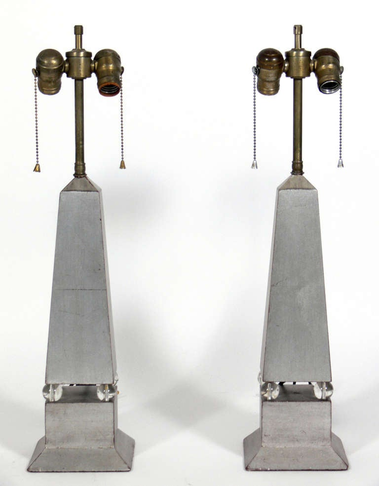 Pair of Silver Leaf Obelisk Lamps, American, circa 1930's. They exhibit wonderful patina and wear to the silver leafing, beautifully exposing some of the Chinese Red underlayer or bole.