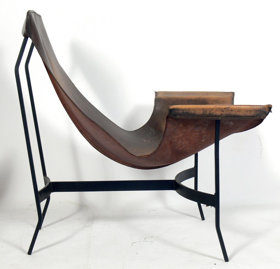 selection of sculptural leather sling chairs is no longer available
