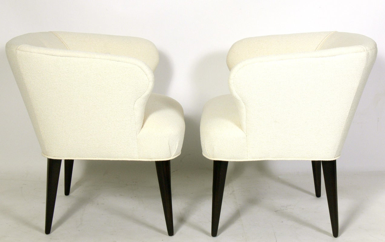 Pair of Curvaceous Tub Chairs, American, circa 1940's. They have been completely restored. Reupholstered in an ivory color boucle fabric and refinished in an ultra deep brown lacquer.