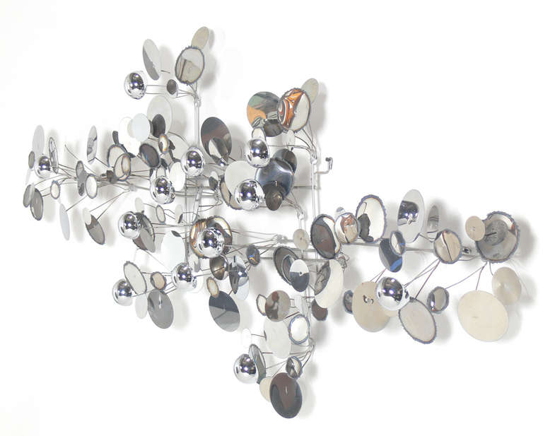 """Large Chrome """"Raindrops"""" Wall Sculpture, made by C. Jere, circa 1970's. Hand signed and dated 1975 on one of the discs. This is one of the cleanest Jere """"Raindrops"""" sculptures we have owned."""