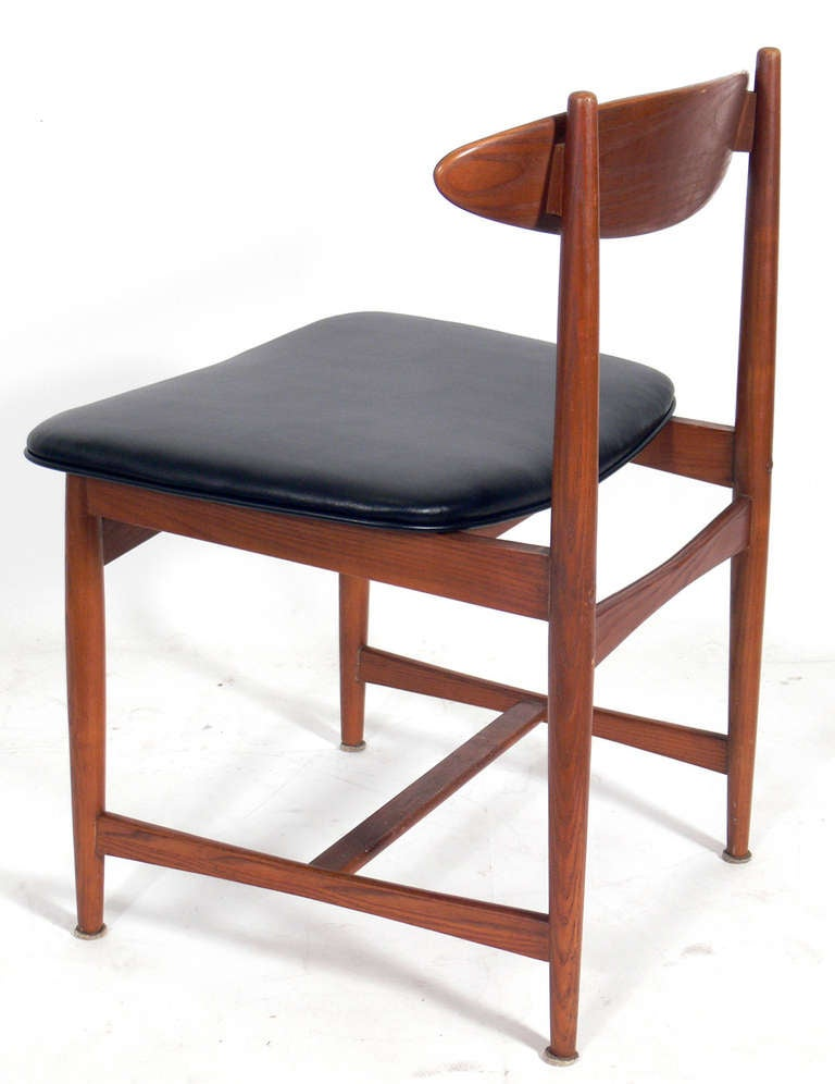 set of four danish modern dining chairs in the manner of