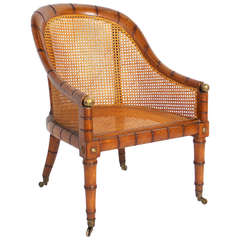 Curvaceous Caned Faux Bamboo Armchair with Brass Hardware
