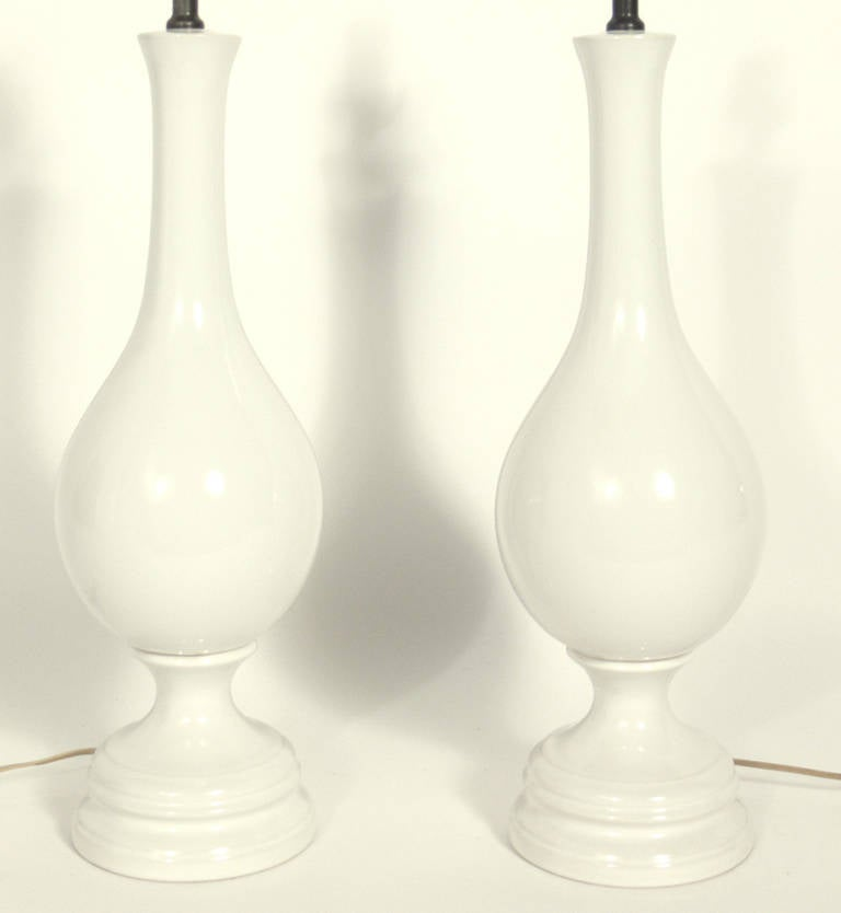 Hollywood Regency Pair of Tall White Ceramic Lamps For Sale