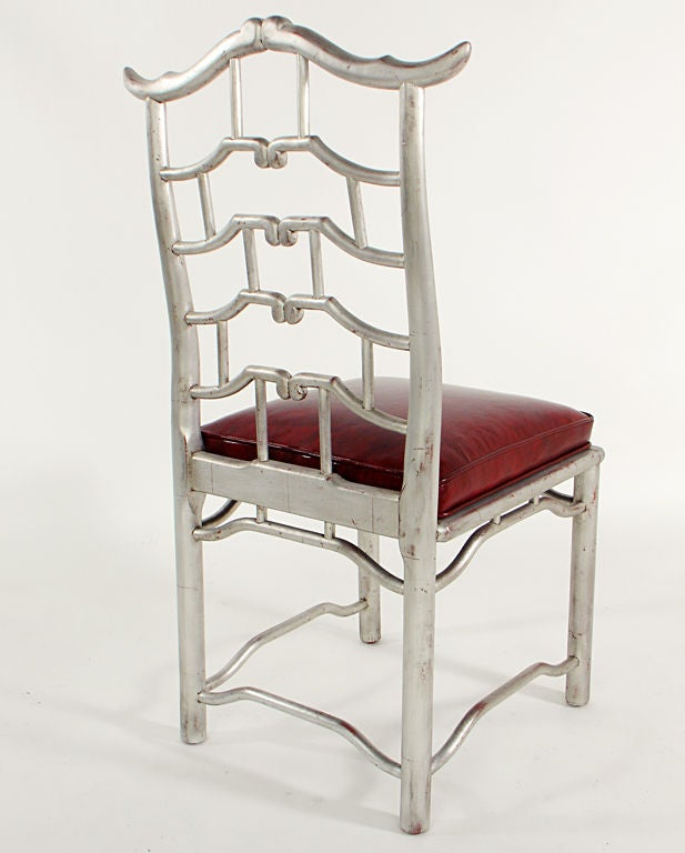 Mid-20th Century Pair of Tall Silver Leaf Asian Fretwork Accent Chairs For Sale
