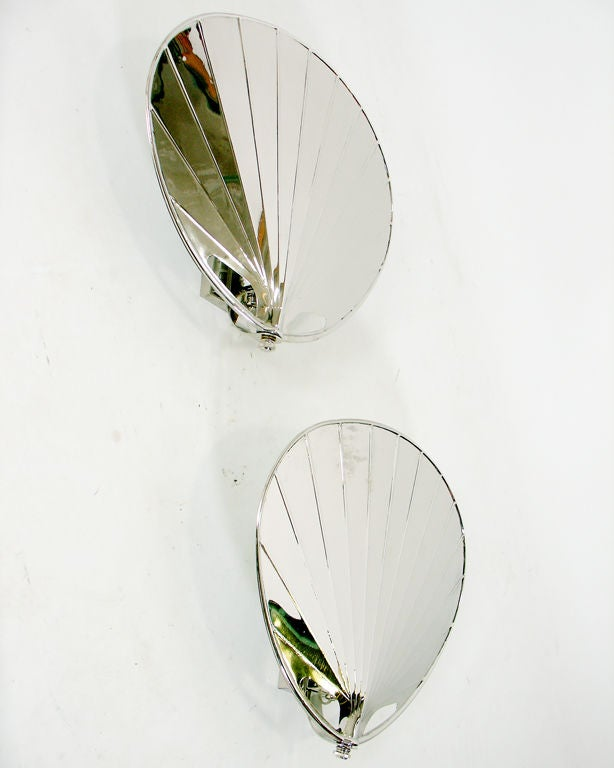 Pair of Modernist Nickel Palm Form Sconces, American, circa 1970's. They have a sleek, sculptural form. Recently replated in nickel. Rewired and ready to mount. The price noted in this listing is for the pair of sconces.