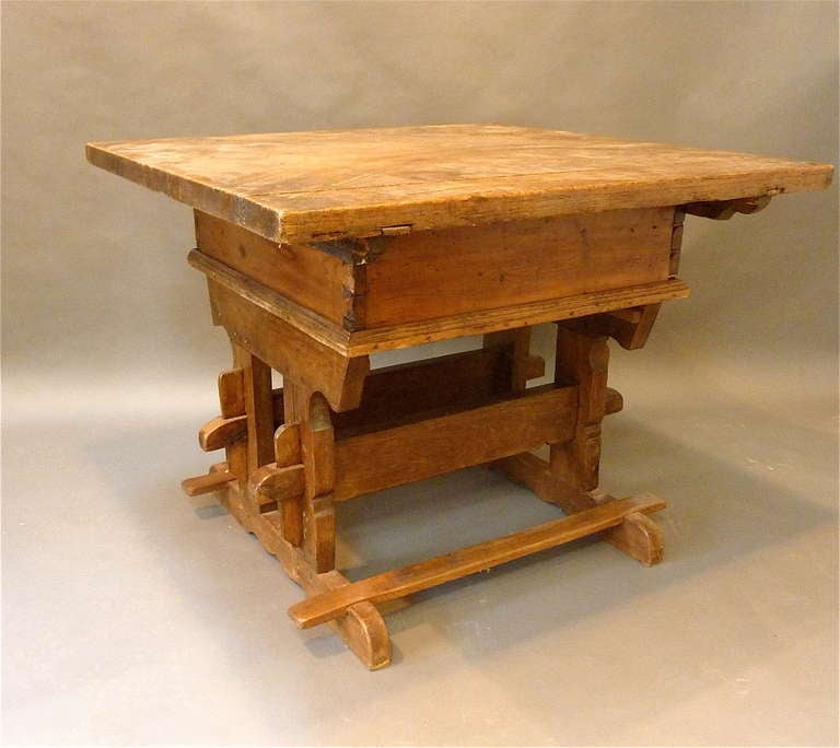 Rare 18th Century Swiss Trestle Table Made Of Golden Colored Pine With A Deep Lustrious