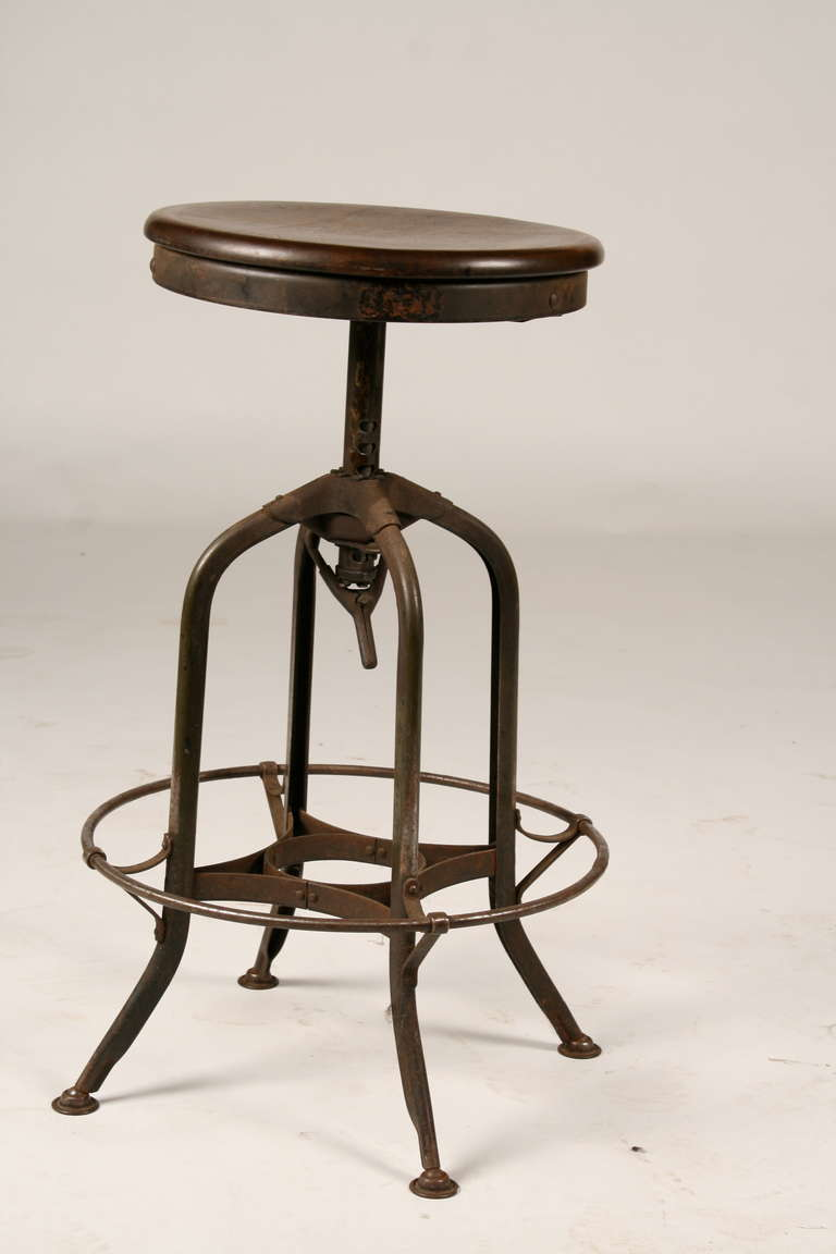 A Set Of Four Toledo And Company Industrial Metal Stools