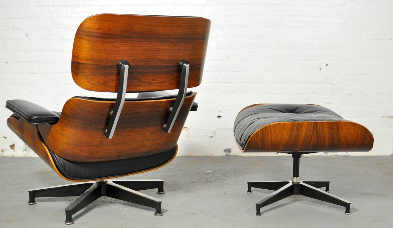 Vintage Rosewood Lounge Chair and Ottoman by Charles Eames