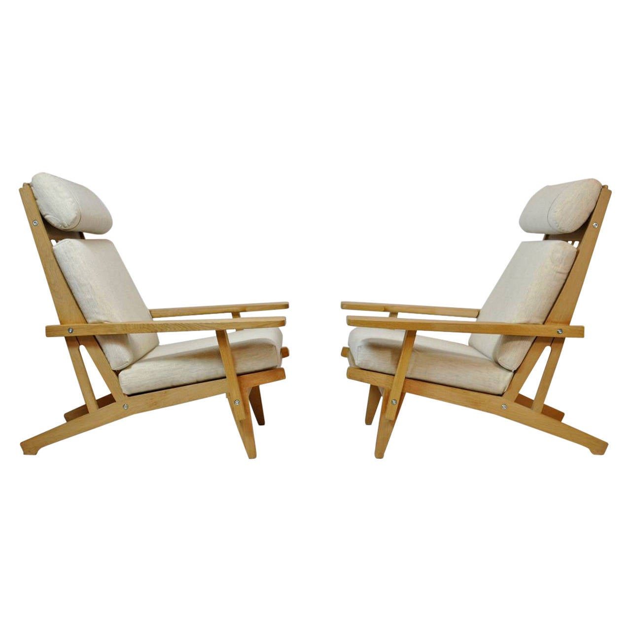 pair of wide arm lounge chairs by hans wegner at 1stdibs
