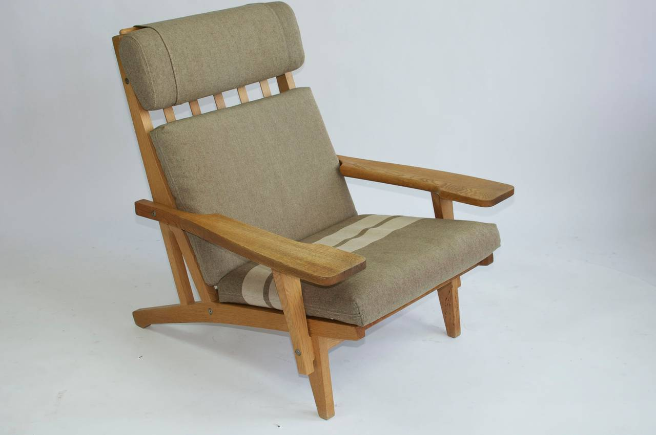 Pair of wide arm lounge chairs by Hans Wegner for GETAMA.