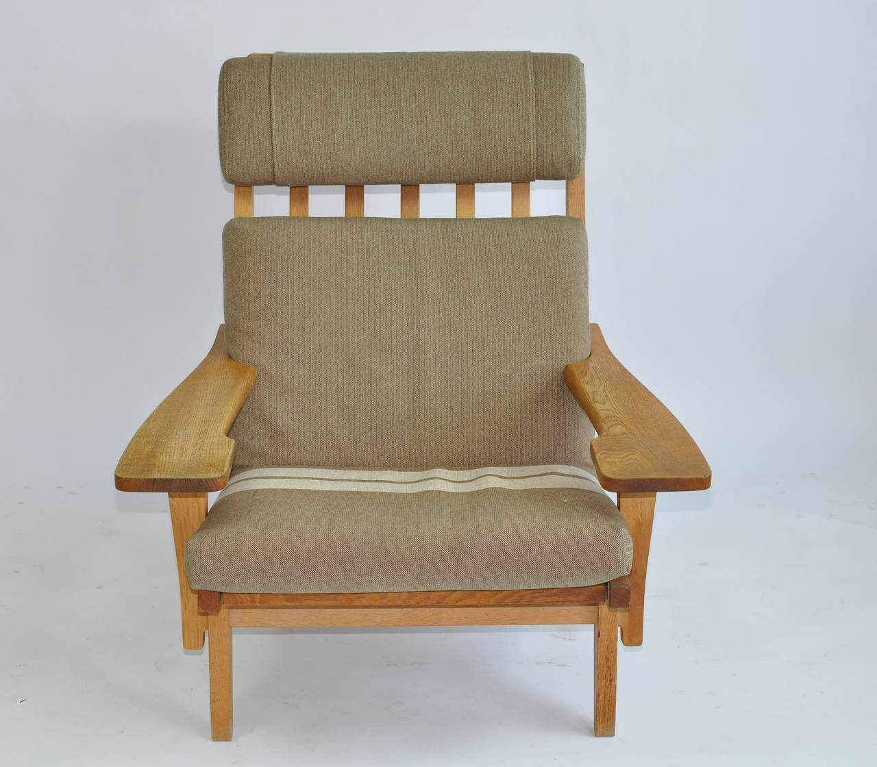 Scandinavian Modern Pair of Wide Arm Lounge Chairs by Hans Wegner For Sale