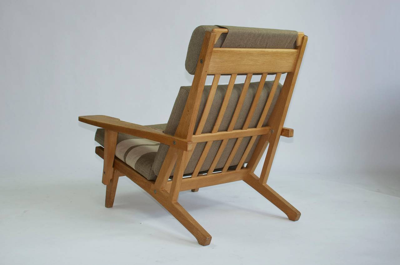 Danish Pair of Wide Arm Lounge Chairs by Hans Wegner For Sale
