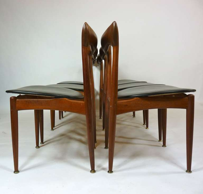 Set of eight teak dining chairs chairs by H.W. Klein for Brahmin.