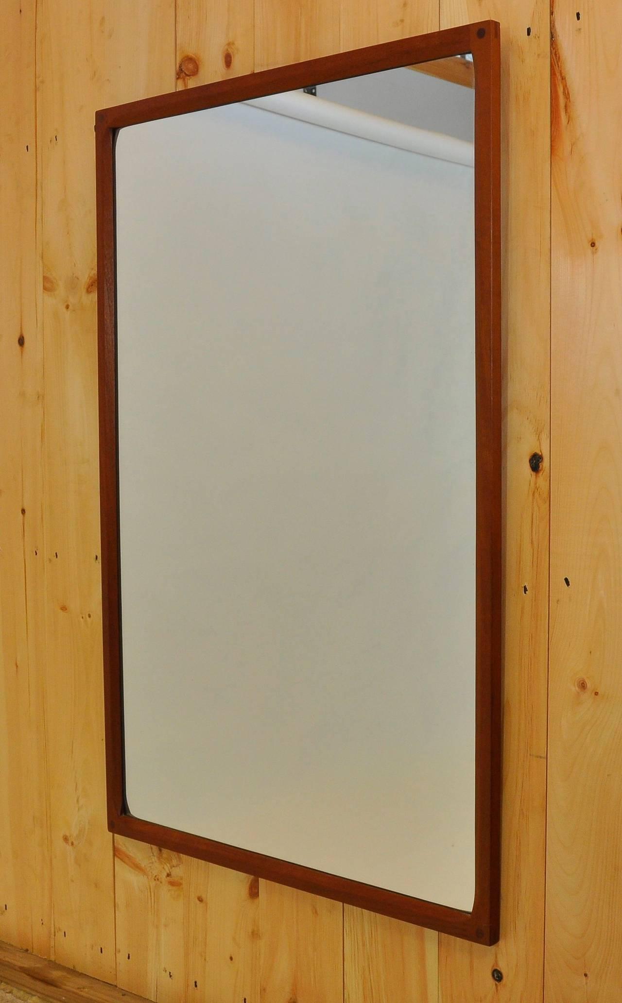 Danish teak mirror by Aksel Kjersgaard.