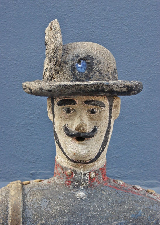 Exceptional 6 ft. tall American Folk Art concrete soldier statue with original paint surface and inset glass 'gem.' Fantastic workmanship. Originally part of a garden estate in South Chicago. Found in the basement of a church in Clinton, OH.